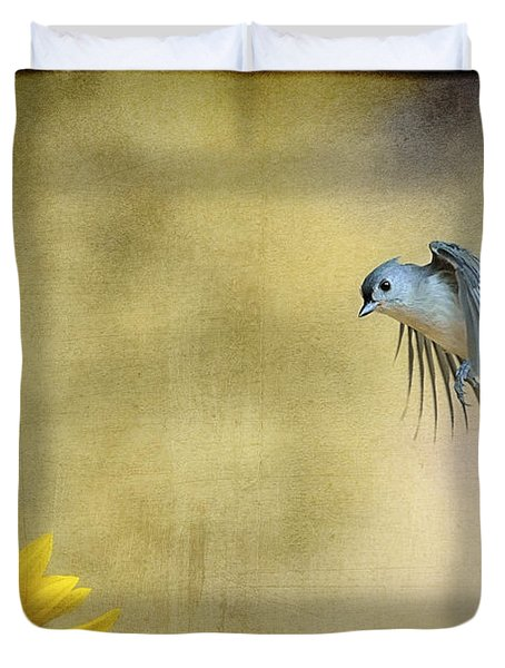 Tufted Titmouse Flying Over Flower Duvet Cover by Dan Friend