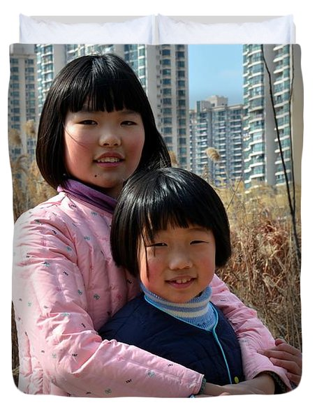 Two Chinese Teen Sisters Hug  And Embrace Shanghai China Duvet Cover