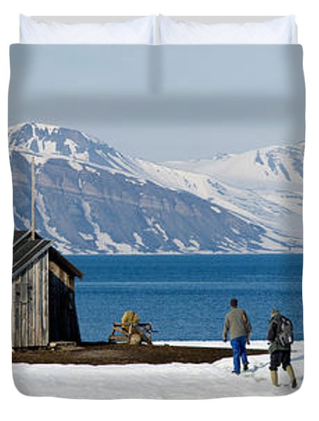 Two Hikers Standing On The Beach Duvet Cover