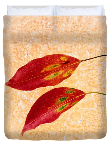 Two Red Leaves On Pink Background Duvet Cover
