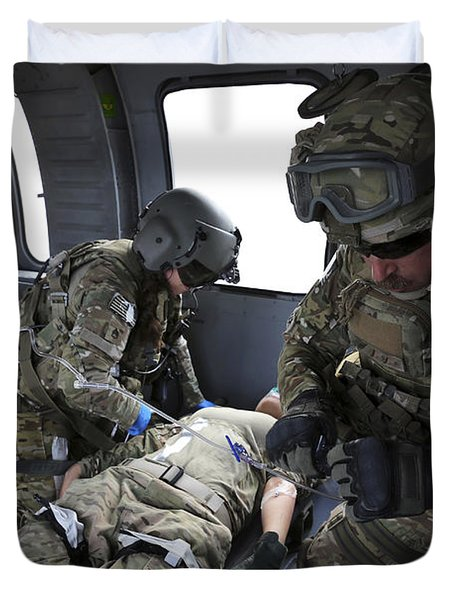 U.s. Army Flight Medics Aid A Simulated Duvet Cover by Stocktrek Images