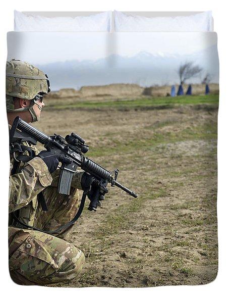 U.s. Soldier Patrols A Village Duvet Cover by Stocktrek Images