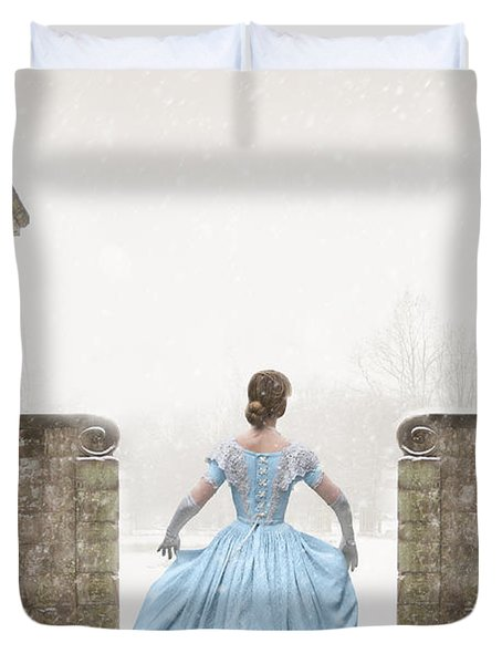 Victorian Woman Running In Snow Duvet Cover by Lee Avison