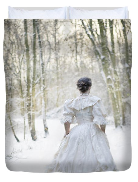 Victorian Woman Running Through A Winter Woodland With Fallen Sn Duvet Cover