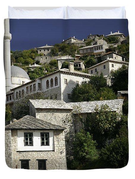 views of pocitelj in Bosnia Hercegovina with minaret bridge and river Duvet Cover