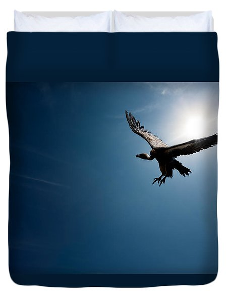 Vulture Flying In Front Of The Sun Duvet Cover by Johan Swanepoel