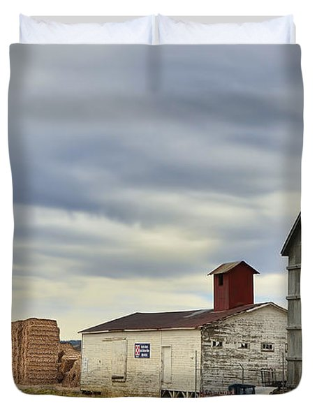 Warbonnet Passing The Grain Elevator Duvet Cover by Ken Smith