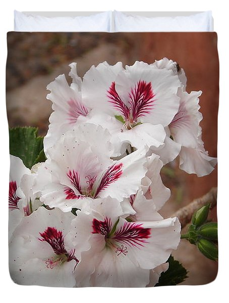 Duvet Cover featuring the photograph White And Red Geraniums by Lew Davis