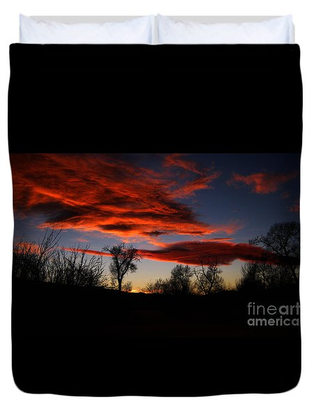 Duvet Cover featuring the photograph Wicked Skies by Janice Westerberg