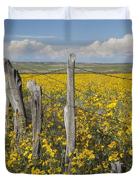 Wildflowers Surround Rustic Barb Wire Duvet Cover by David Ponton