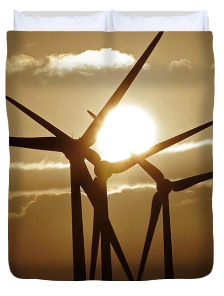Wind Turbines Silhouette Against A Sunset Duvet Cover