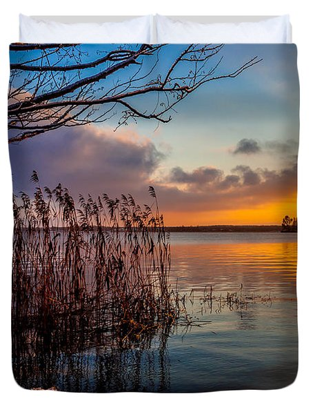 Winter Lake Sunset With A Tree Lighted In Red And Orange  Duvet Cover by Julis Simo