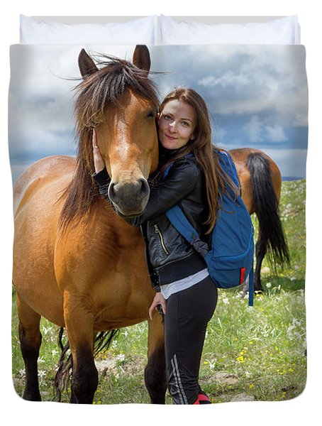 Woman Embracing Horse At Mountain Duvet Cover