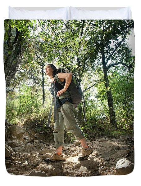 Woman With A Backpack Hiking Duvet Cover