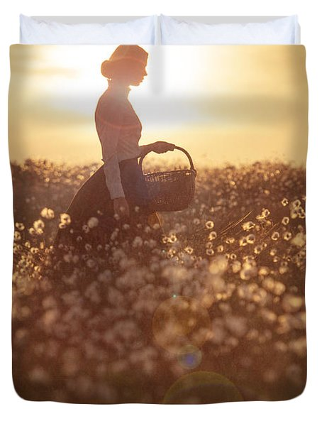 Woman With A Wicker Basket At Sunset Duvet Cover by Lee Avison