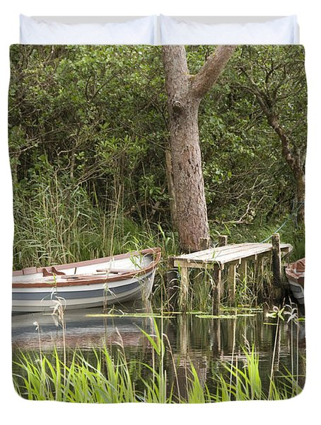 Duvet Cover featuring the photograph Wooden Boats by Jeremy Voisey