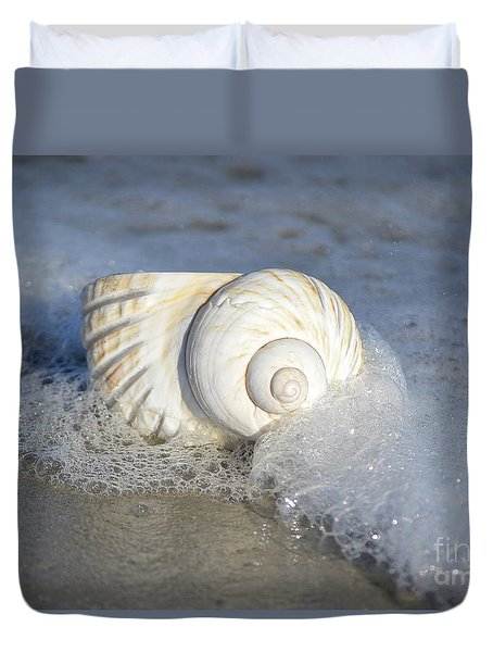 Duvet Cover featuring the photograph Worn By The Sea by Kathy Baccari