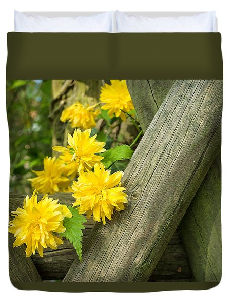 Yellow Flowers And Fence Duvet Cover