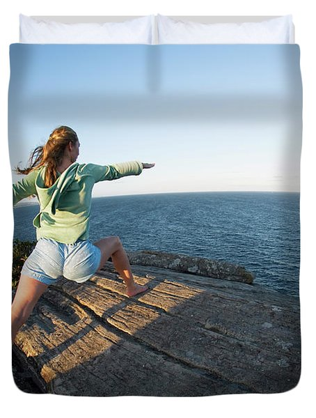 Yoga On Rocky Outcrop Above Ocean Duvet Cover