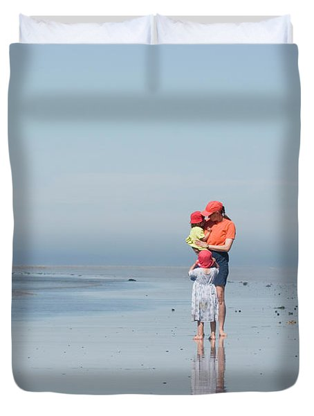 Young Mother Walks Along Beach Duvet Cover