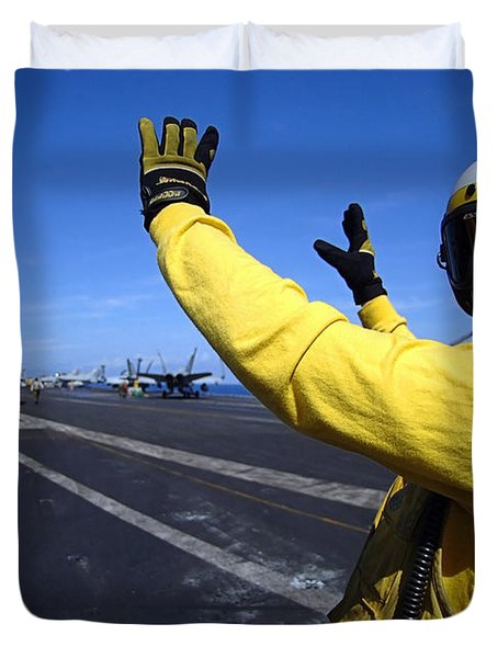An Aviation Boatswains Mate Directs Duvet Cover by Stocktrek Images