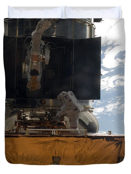 Astronauts Working On The Hubble Space Duvet Cover by Stocktrek Images
