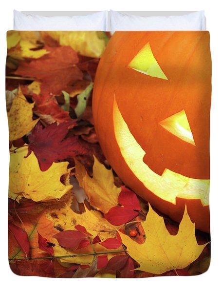 Carved Pumpkin On Fallen Leaves Duvet Cover by Oleksiy Maksymenko
