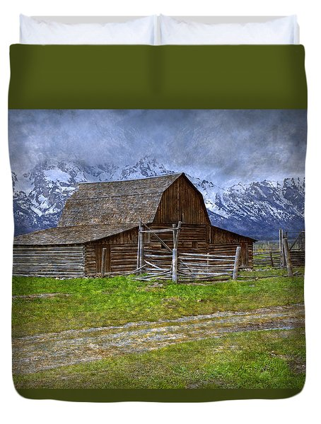 Grand Teton Iconic Mormon Barn Fence Spring Storm Clouds Duvet Cover by John Stephens