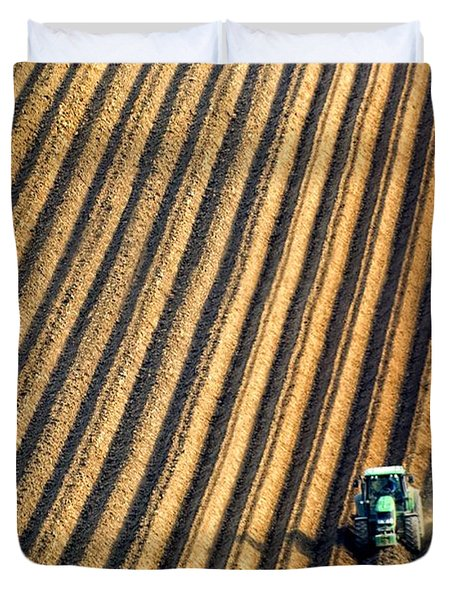 Tractor Plowing A Field Duvet Cover by John Short