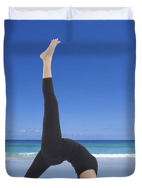 Woman Doing Yoga On The Beach Duvet Cover by Setsiri Silapasuwanchai