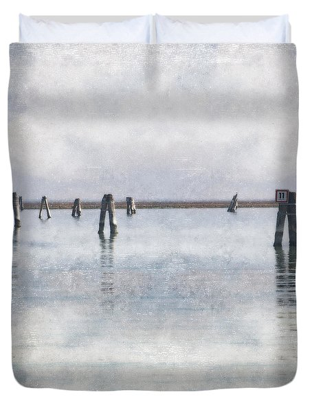 wood piles in the lagoon of Venice Duvet Cover by Joana Kruse