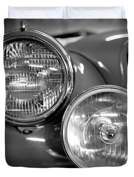 1952 Jaguar Headlights Duvet Cover by Sebastian Musial