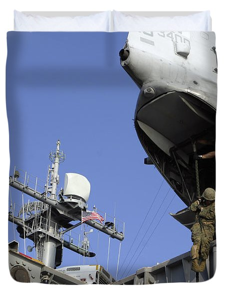 A Soldier Fast-ropes From The Rear Duvet Cover by Stocktrek Images