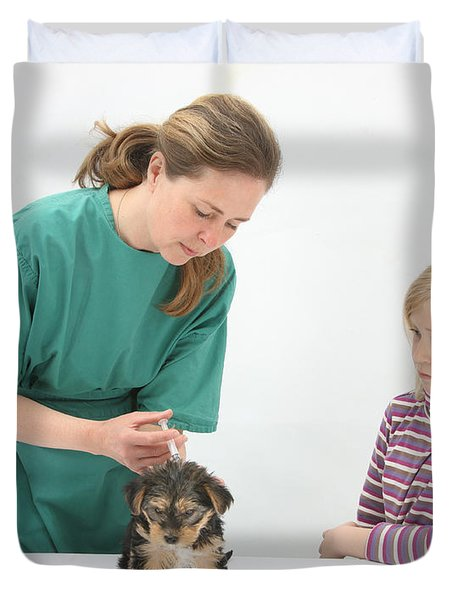 Vet Giving Pup Its Primary Vaccination Duvet Cover by Mark Taylor