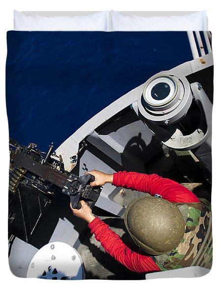 A Sailor Fires A .50-caliber Machine Duvet Cover by Stocktrek Images