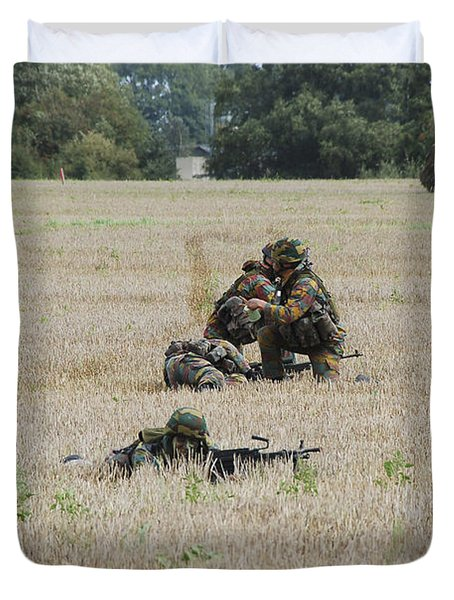 Evacuation Of A Wounded Soldier By An Duvet Cover by Luc De Jaeger