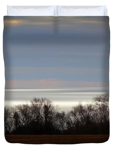 Duvet Cover featuring the photograph A Break In The Clouds by Davandra Cribbie