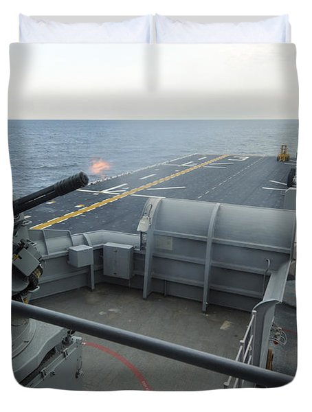 A Close-in Weapons System Fires Aboard Duvet Cover