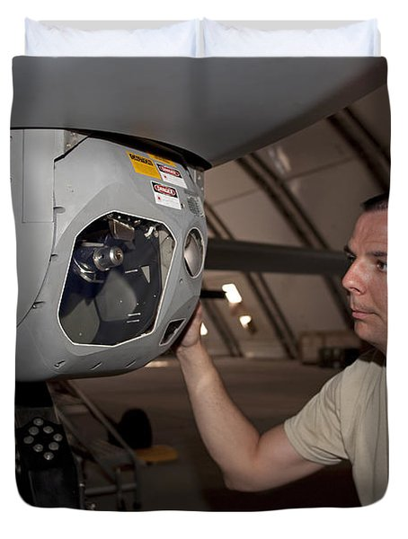 A Crew Chief Works On Mq-1 Predators Duvet Cover by HIGH-G Productions