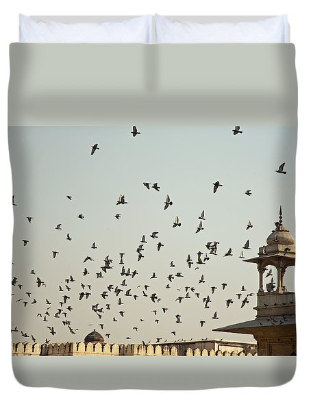 A Flock Of Pigeons Crowding One Of The Structures On Top Of The Red Fort Duvet Cover by Ashish Agarwal
