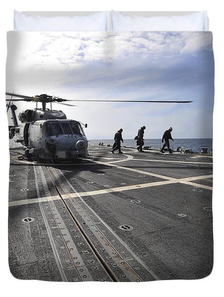 A Helicpter Sits On The Flight Deck Duvet Cover by Stocktrek Images