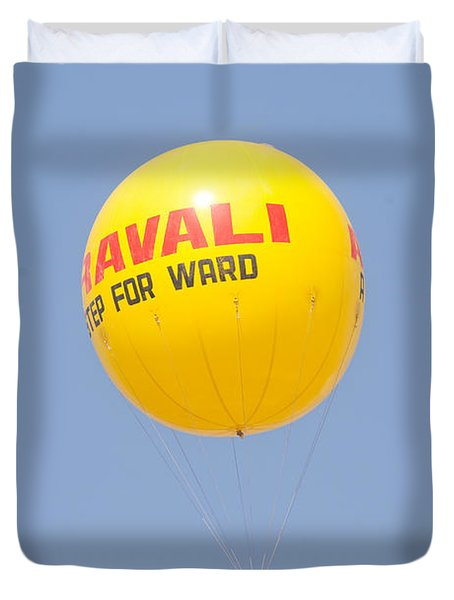 Duvet Cover featuring the photograph A Hot Air Balloon In The Blue Sky by Ashish Agarwal