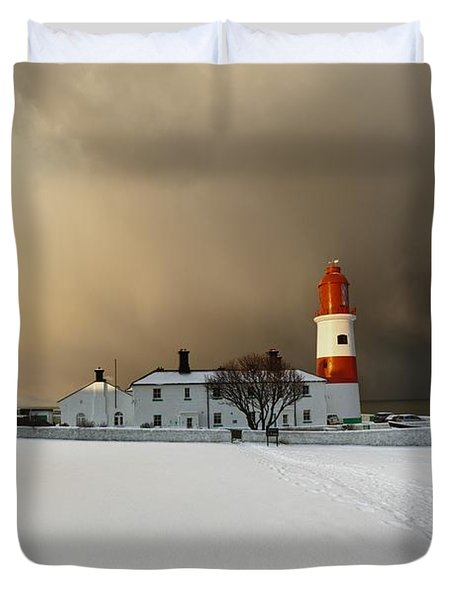 A Lighthouse And Building In Winter Duvet Cover by John Short