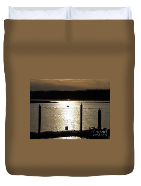 A Lone Boat At Sunset Duvet Cover by Chalet Roome-Rigdon