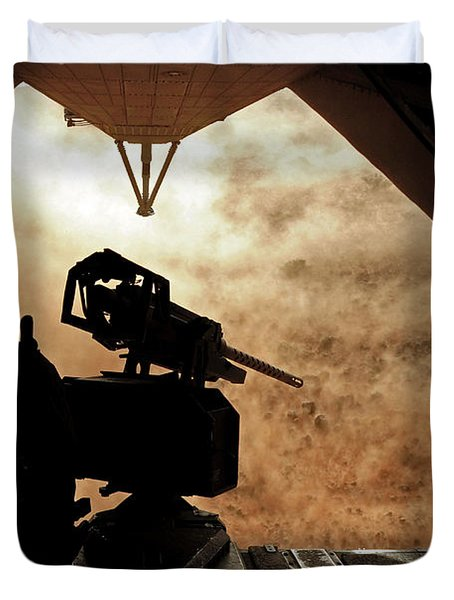 A Marine Waits For Dust To Clear While Duvet Cover by Stocktrek Images
