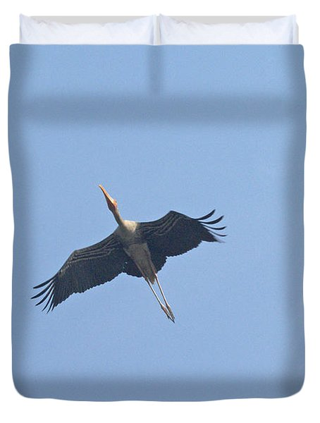 A Painted Stork Flying High In The Sky Duvet Cover by Ashish Agarwal