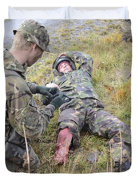 A Patrol Medic Applies First Aid Duvet Cover by Andrew Chittock