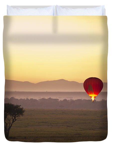 A Red Hot Air Balloon Takes Flight Duvet Cover by David DuChemin