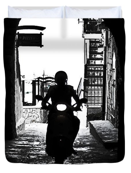 a scooter rider in the back light in a narrow street in Italy Duvet Cover by Joana Kruse