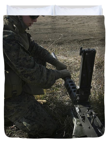A Soldier Changes The Barrel Of An M2 Duvet Cover by Stocktrek Images